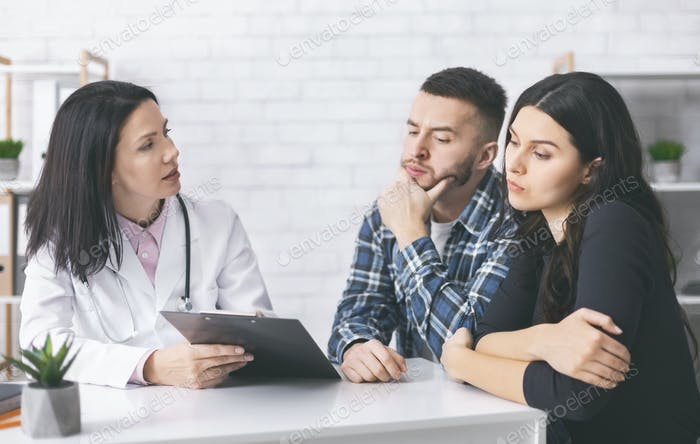 Young man and woman reading doctor's prescriptions for infertility cure