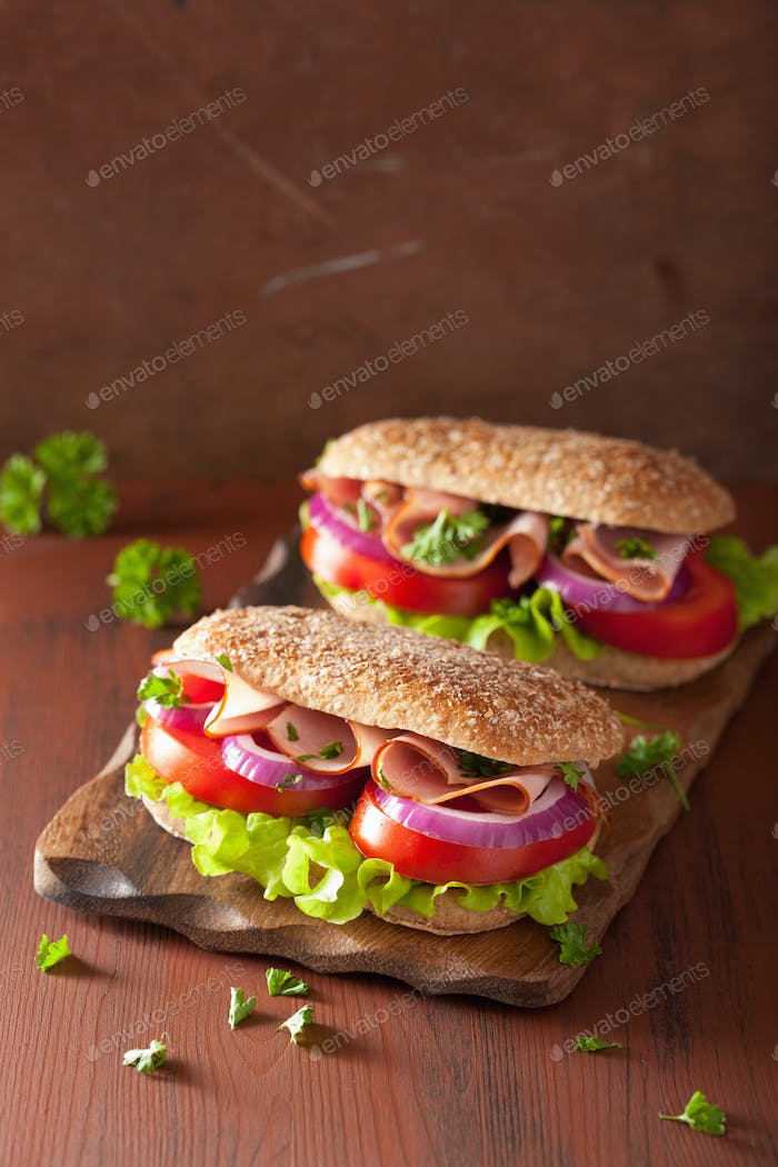 sandwich with ham tomato and lettuce