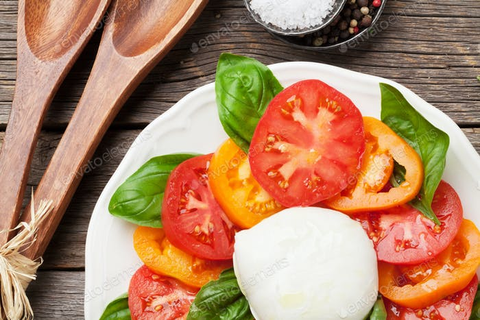 Caprese salad with tomatoes, basil and mozzarella