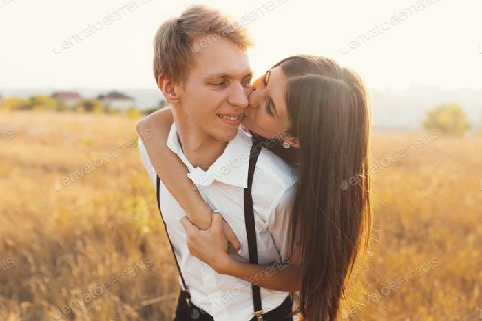 Carefree couple having a good time together, enjoying love, fres
