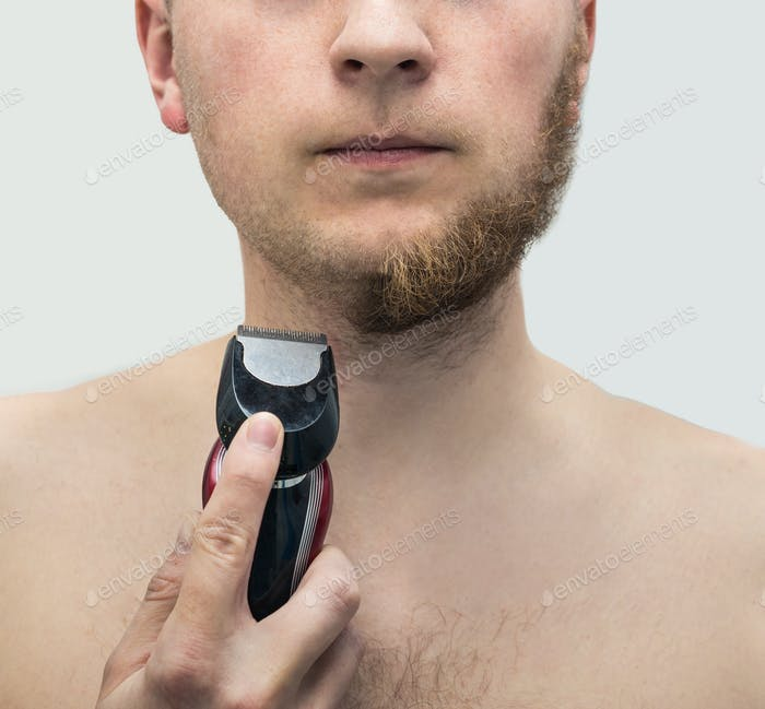 Young hipster man shaved half of beard