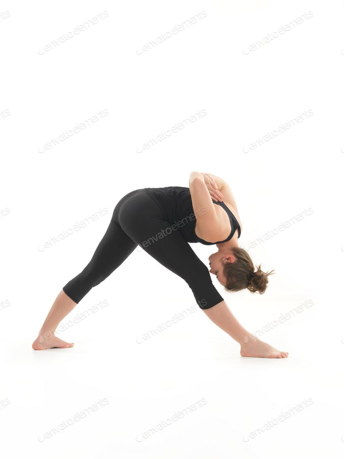 yoga posture demonstration by young female instructor