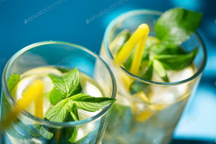 Fragments of glasses of homemade lemonade with mint