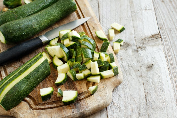 Fresh zucchini on wooden board