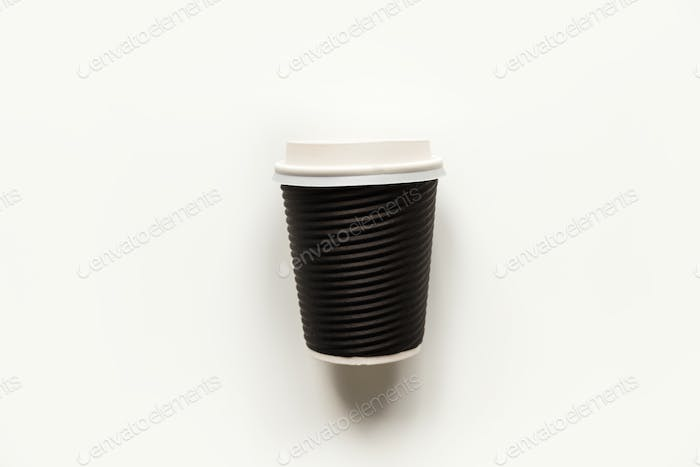 Black paper coffee cup for take out isolated on white. Mock-up