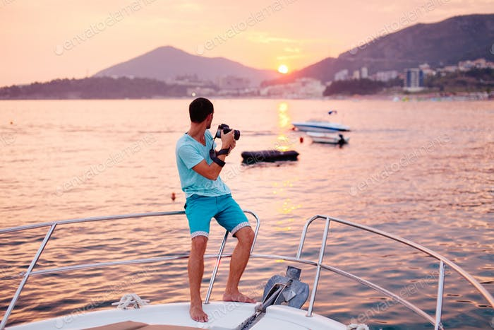 tourist man travel on yacht at sunset
