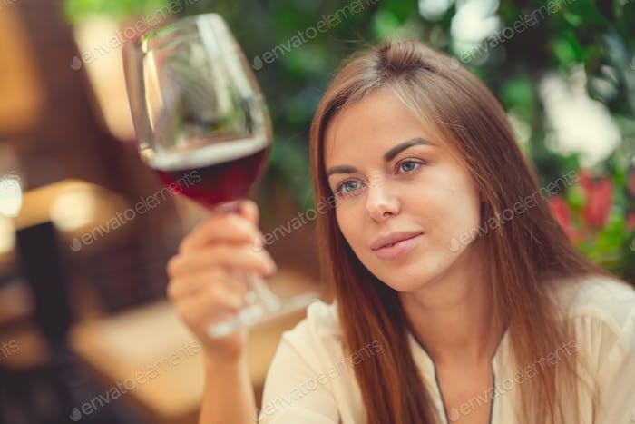 Woman tasting a wine