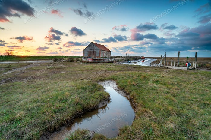 Sunset over the old coal barn at Thornham