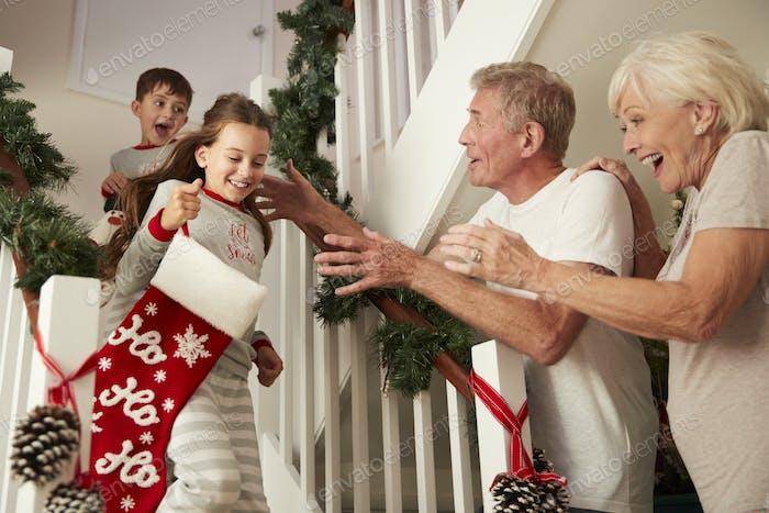 Grandparents Greeting Grandchildren On Christmas Morning