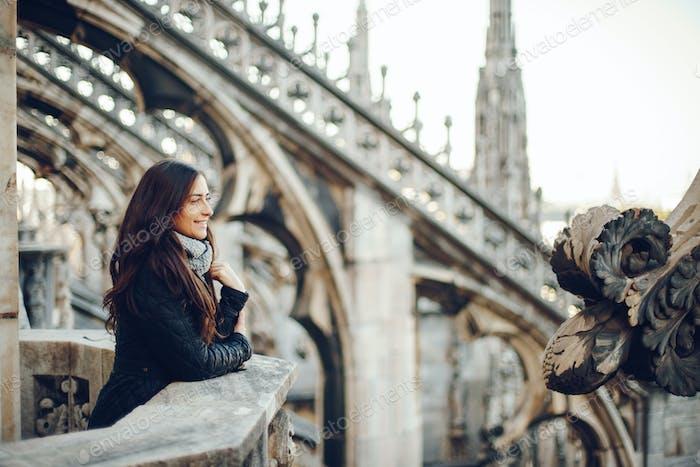 female tourist exploring the duomo in Milan