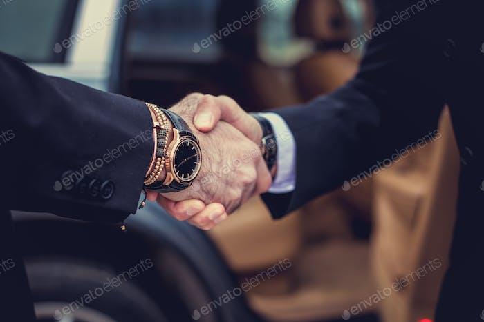 Two men handshake.