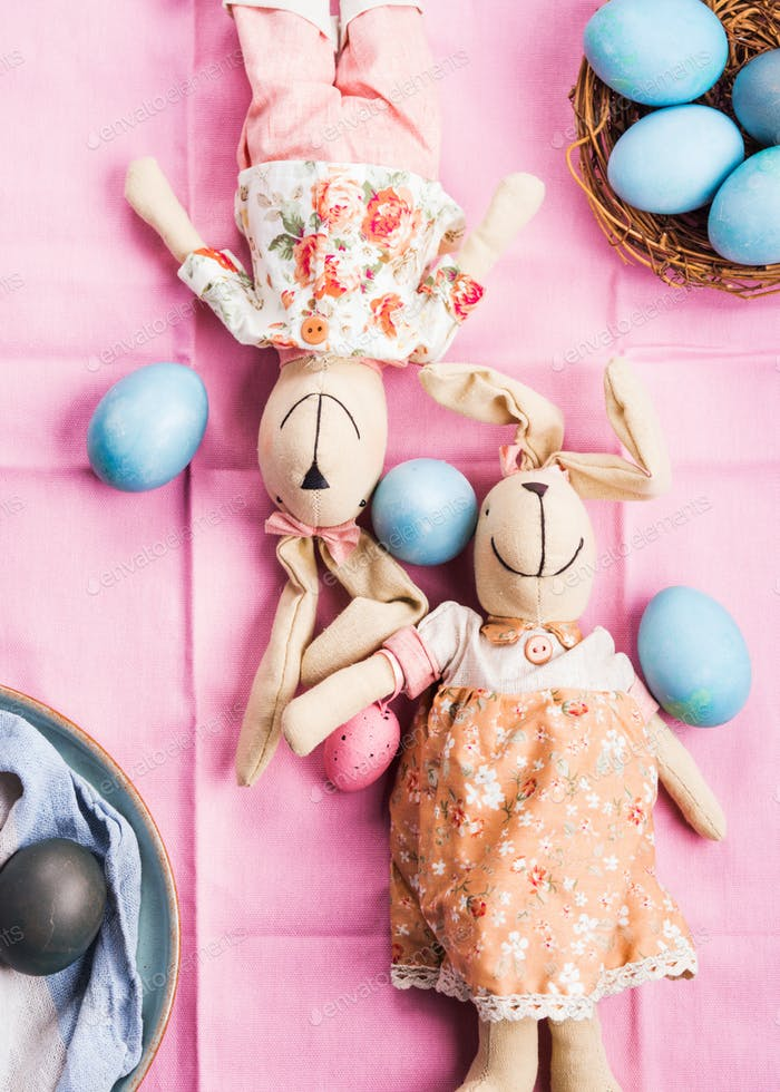 Pink easter holiday concept with bunnies and eggs