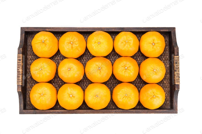 Juicy mandarin oranges in tray with white background