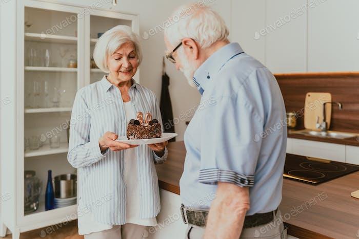 Senior couple celebrating birthday at home