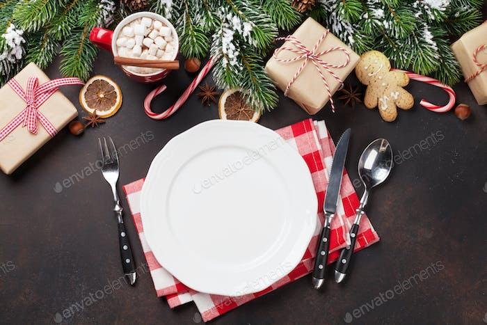 Christmas dinner plate, silverware, fir tree, gifts
