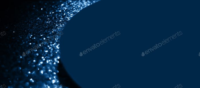Color blue glitter trendy festive background. 2020 year trend