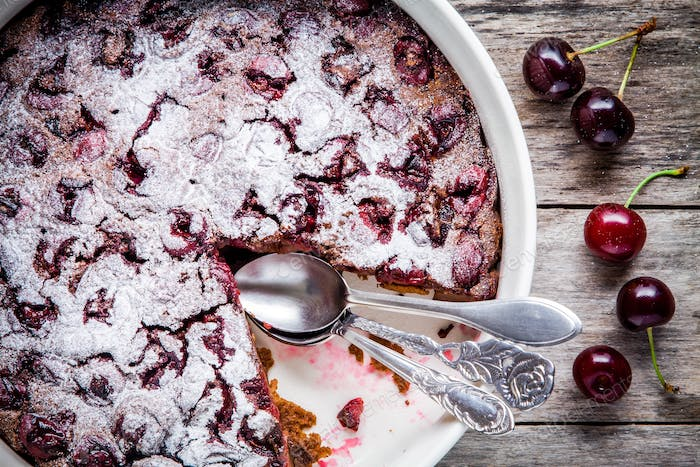 Clafoutis chocolate cake with cherries closeup
