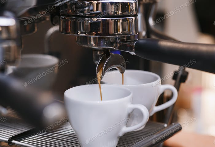 Closeup Of Working Coffee Machine, Barista Making Espresso In Coffeeshop