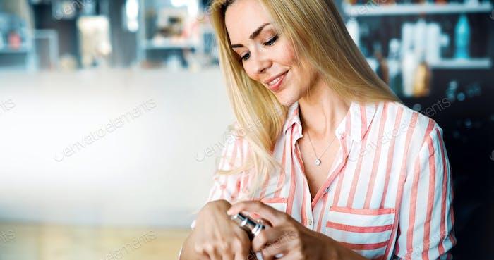 Beautiful young lady applying moisturizing creme