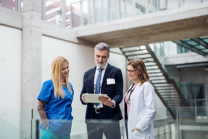 Group of doctors talking to pharmaceutical sales representative