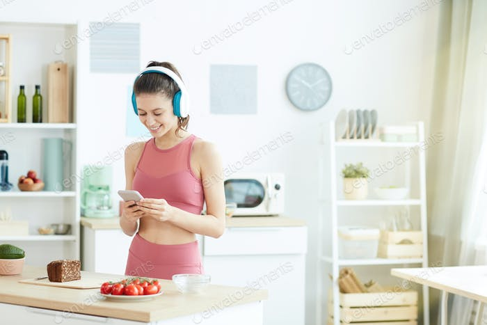 Fit Young Woman Making Healthy Snack