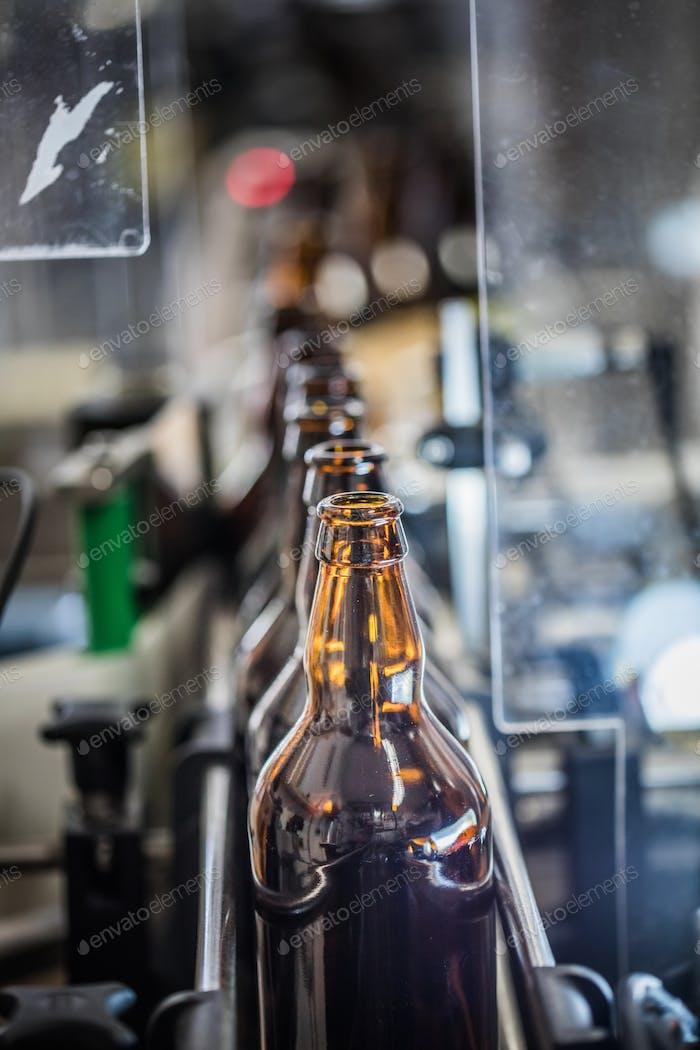 Row of bottles on conveyor