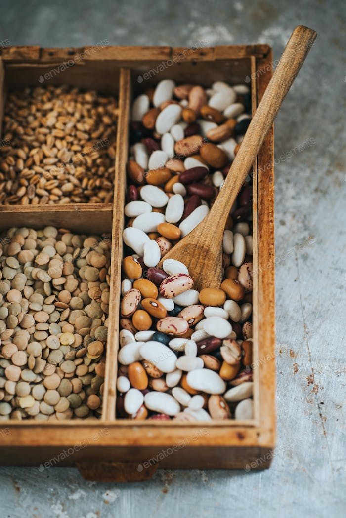 Diferent beans and grains in wooden box