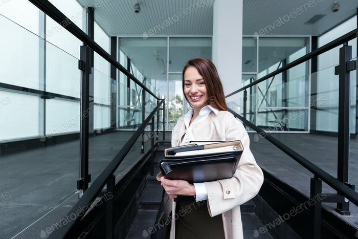 Portrait of young beautiful businesswoman going to office