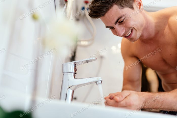 Man washing face in morning