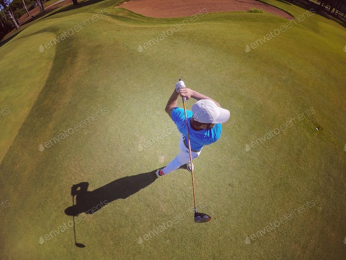 top view of golf player hitting shot