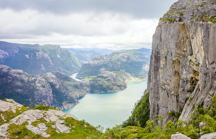 People hiking at the Pulpit Rock in lysefjorden Norway