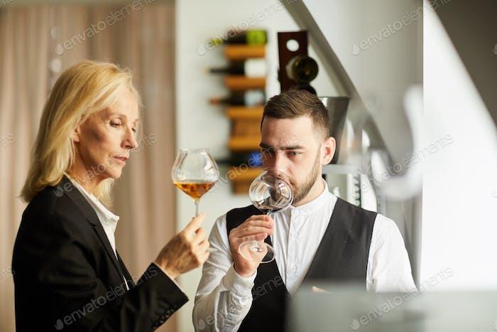 Sommeliers Tasting Wine