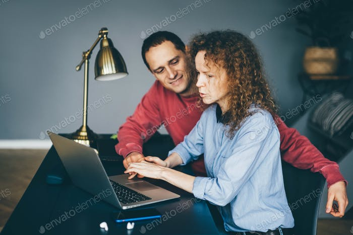 Freelance couple working from home.