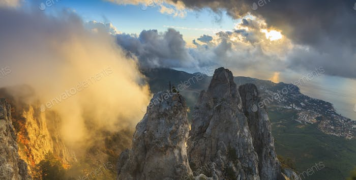 Panorama of rocks at sunrise in dramatic clouds