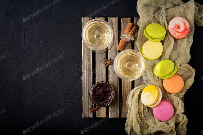 dry white wine and a macaroon. Flat lay. Top view.