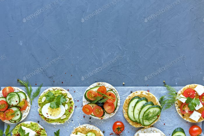 Border of savory appetizers or canapes