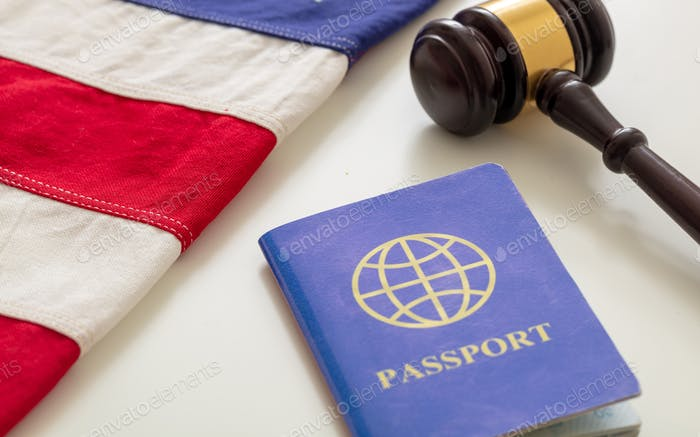 Blue passport, law gavel and USA flag on white background, close up view.