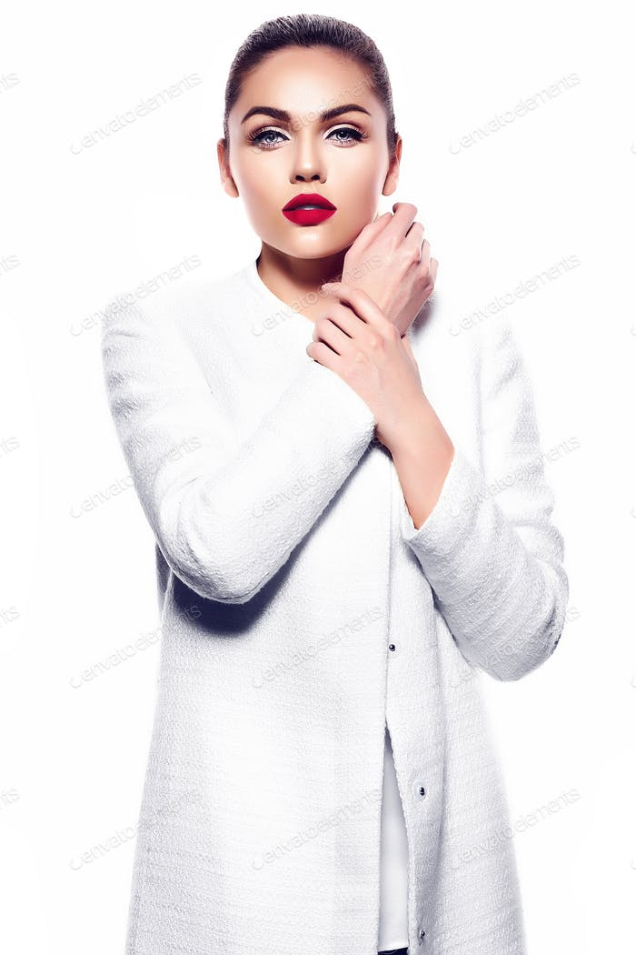 Fashion portrait of young beautiful woman with red lips