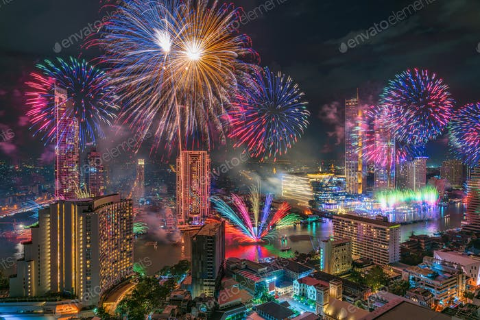 Fantastic Multicolor Firework exploding over the Bangkok Cityscape river side for Celebration