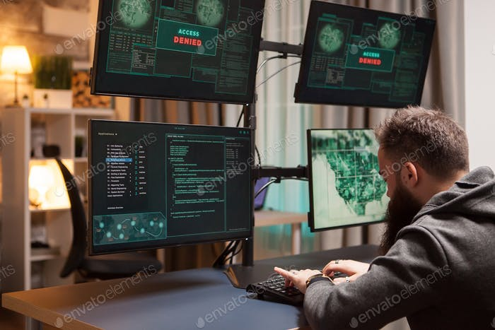 Bearded cyber terrorist gets access while typing a virus