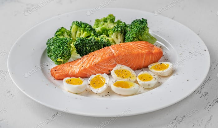 Cooked salmon with broccoli and eggs