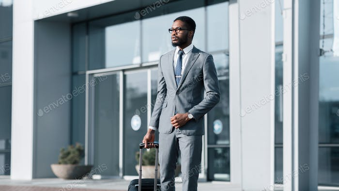 Confident Black Entrepreneur Leaving Airport Arriving On Business Journey, Panorama
