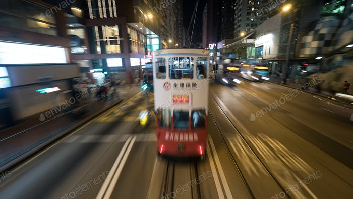 Double-decker tram and buses in night Hong Kong