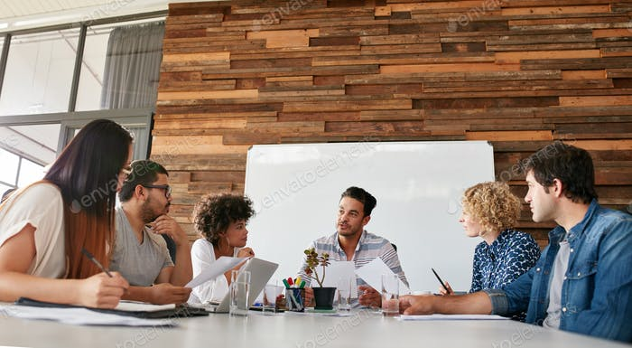 Creative team discussing new strategy of their company