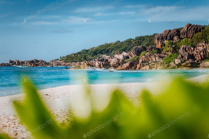 Picturesque Grand Anse tropical beach in La Digue, Seychelles with its famous granite rock