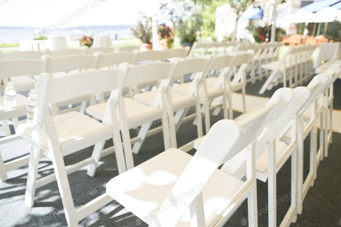 45663,Rows of White Folding Chairs