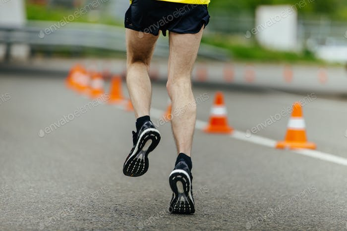 male feet in running shoes