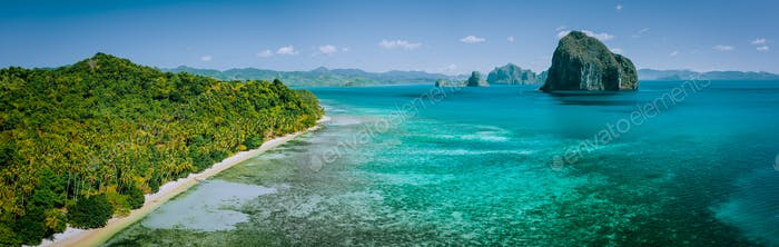 Panoramic drone aerial view of coastal scenery from the mainland Palawan with tropical Pinagbuyutan