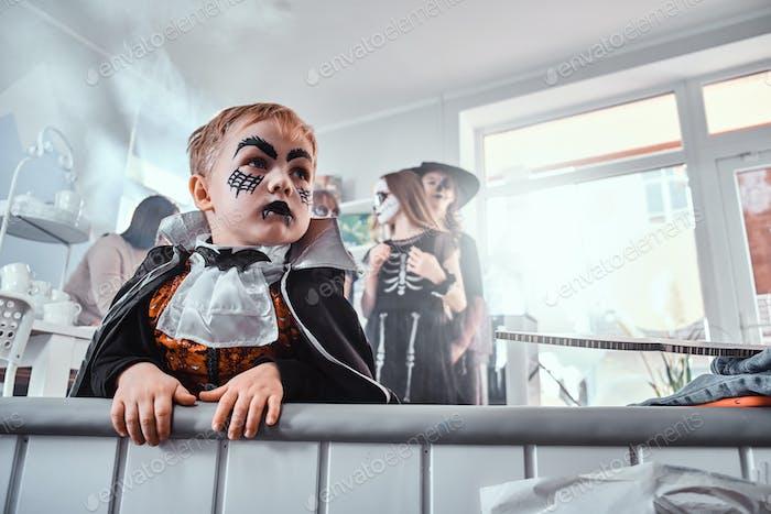 Little boy vampire on Halloween party