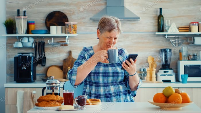 Leisure morning for senior woman using technology